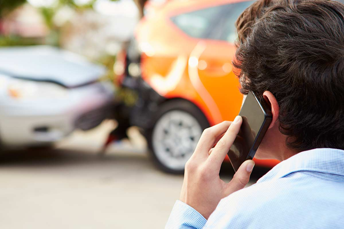 Man calling in an accident report